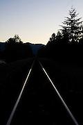 Tracks of the Burlington Northern Santa Fe (BNSF) Railway at dusk outside Cle Elum, Washington.