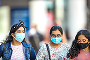 London, England, the United Kingdom, July 15, 2021: General views show people (some of them) wearing masks as they walk across central London on Thursday, July 15, 2021. England prepares to lift all covid restrictions from 19th July amid different approaches to mask-wearing from local governments to private companies. The UK recorded more than 50.000 covid cases this week, the highest daily number in months. (VX Photo/ Vudi Xhymshiti)