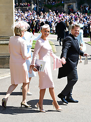 James Corden and Julia Carey at St George's Chapel at Windsor Castle after the wedding of Meghan Markle and Prince Harry.