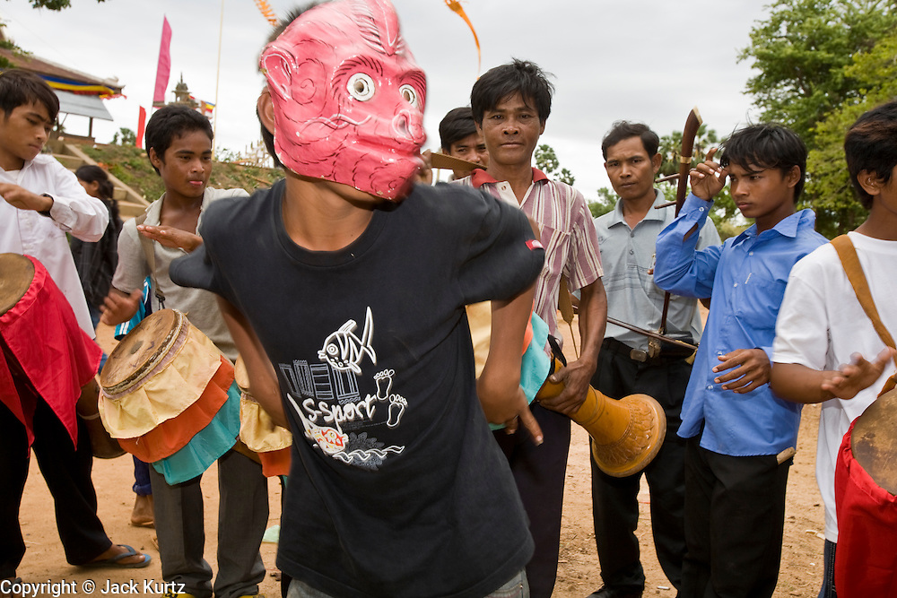 02 JULY 2006 - UDONG, CAMBODIA: Traditional dancers perform during a ceremony to mark young men and boys becoming monks at a small monastery near Udong, Cambodia. Photo by Jack Kurtz / ZUMA Press