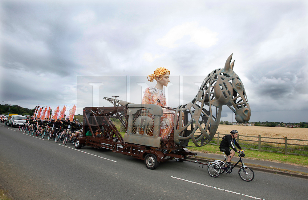© Licensed to London News Pictures.30/07/2012. Rugby, UK. A 6m-high puppet of Lady Godiva arrived in Rugby today on the first stop of its journey from Coventry to London to celebrate the Olympics. The puppet, transported using a bike called the Cyclopedia, and powered by 100 cyclists will go to Northampton, Milton Keynes, Luton, Hatfield and Waltham Abbey before arriving at Waltham Forest on 5 August. Pictured the puppet travels through the countryside between Dunchurch and Rugby..Photo credit : Dave Warren/LNP