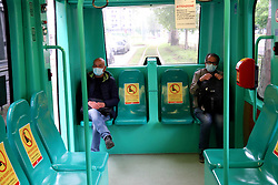 Passengers wearing protective masks follow the rules of social distancing signs as a precautionary measure to avoid COVID-19 infection during the gradual opening of phase 2 of the Coronavirus, lockdown will be lifted and activities of daily living will begin progressively. on April 27, 2020 in Milan, Italy. Photo by Clemente Marmorino/Eyepix/ABACAPRESS.COM