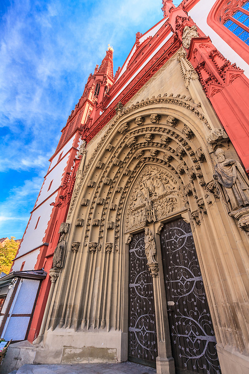 St Mary's Chapel in Würzburg, Germany. The chapel is a masterpiece of late Gothic architecture. The arches of the doorways represent elaborate ornamentation.