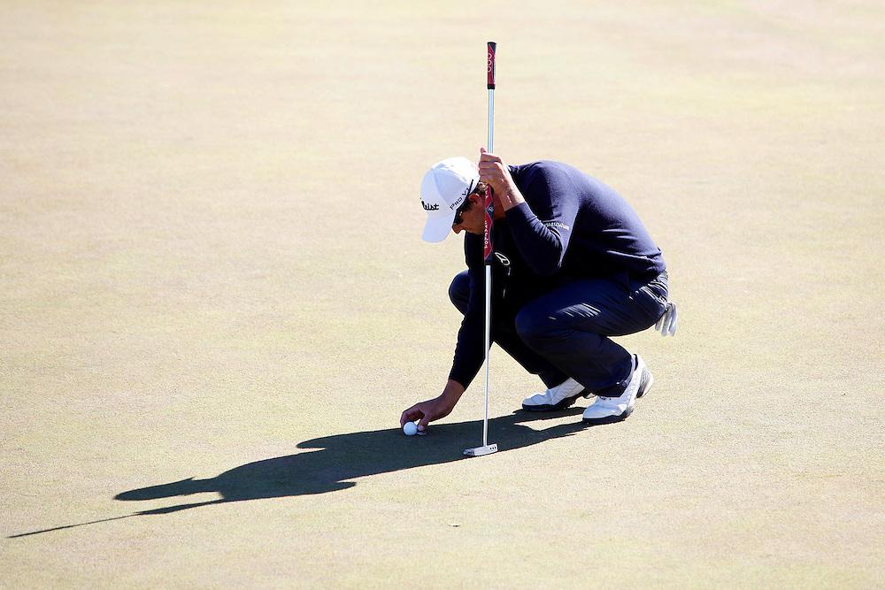 Adam Scott prepares for this winning putt at the Talisker Masters, Kingston Heath, Melbourne