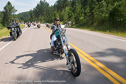 Debi Holmes on the Aidan's Ride to raise money for the Aiden Jack Seeger nonprofit foundation to help raise awareness and find a cure for ALD (Adrenoleukodystrophy) during the annual Sturgis Black Hills Motorcycle Rally. Vanocker Canyon between Sturgis and Nemo, SD, USA. Tuesday August 8, 2017. Photography ©2017 Michael Lichter.