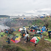 View of the Idomeni camp where it has been raining non stop for the last few days. Transit camp of Idomeni, Greece. <br /> <br /> Thousands of refugees are stranded in Idomeni unable to cross the border. The facilities are stretched to the limit and the conditions are appalling.