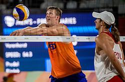 09-08-2016 BRA: Olympic Games day 3, Rio de Janeiro<br /> Reinder Nummerdor en Christiaan Varenhorst hebben ook hun tweede wedstrijd gewonnen 2-1. De beachvolleyballers rekenden af met de Polen Grzegorz Fijalek en Mariusz Prudel.