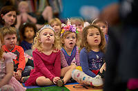"""Children listen as Shabaz Ujima of the Nashville Ballet reads """"Little Cloud"""" by Eric Carle during story time at the Nolensville Library's pre-school Story Time  on March 13, 2019. Photo: Harrison McClary/News & Observer"""