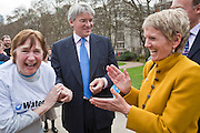 Andrew Mitchell  MP, Barbara Frost and a WaterAid campaigner walking for water. . Marking World Water Day, over 40 MP's walked for water at Westminster, London at an event organised by WaterAid and Tearfund. Globally hundreds of thousands of people took part in the campaign to raise awareness of the world water crisis.