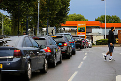 © Licensed to London News Pictures. 01/10/2021. London, UK. Motorists queue for the eighth day at Sainsbury's petrol station in north London as the fuel crisis enters its second week. There are continuing fears of fuel running out due to a shortage of HGV drivers. Photo credit: Dinendra Haria/LNP