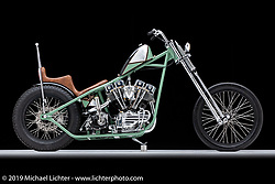 """Nick Pensebene's 3-Peat is a custom 1967 Shovelhead Chopper, complete with a custom built Butteras Metal Werx frame and a Ron Finch front end. He name the chopper 3-Peat due to the fact this is his third year in the Motorcycles as Art Exhibit.  Since Nick decided to name this bike the """"3Peat"""" he tied the number 3 into parts of the chopper using intervals of three and three sided figures (although I'm not going to tell you where they are). While You are looking at the bike, see if you can find them. Photographed by Michael Lichter in Sturgis, SD. August 1, 2019. ©2019 Michael Lichter"""