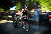 Jim Cunningham of Seattle runs his bike out of the starting gate Saturday June 26, 2006 during Ironman Coeur d'Alene.