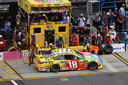 September 30, 2018 - Concord, North Carolina, United States of America - Kyle Busch (18) brings his car down pit road for service during the Bank of America ROVAL 400 at Charlotte Motor Speedway in Concord, North Carolina. (Credit Image: © Chris Owens Asp Inc/ASP via ZUMA Wire)