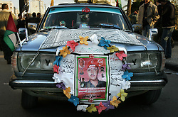 Palestinians are seen mourning, after the bodies of 15 militants were returned by Israel, Gaza, Palestinian Territories, Feb. 7, 2005. The Israeli military delivered the bodies to the Palestinians for burial. A handover celebrated in Gaza as the first real achievement of leader Mahmoud Abbas, also known as Abu Mazen, who is trying to prevent militants from straying from a fragile truce.