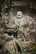 View of a Laughing Buddha statue carved in stone, Lingyin Buddhist temple, Hangzhou, Zhejiang Province, China