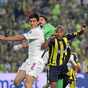 Fenerbahce's Deivid de SOUZA (R) and Trabzonspo's Ceyhun GULSELAM (L), goalkeeper Onur Recep KIVRAK (C) during their Turkish superleague soccer derby match Fenerbahce between Trabzonspor at the Sukru Saracaoglu stadium in Istanbul Turkey on Sunday 16 May 2010. Photo by TURKPIX