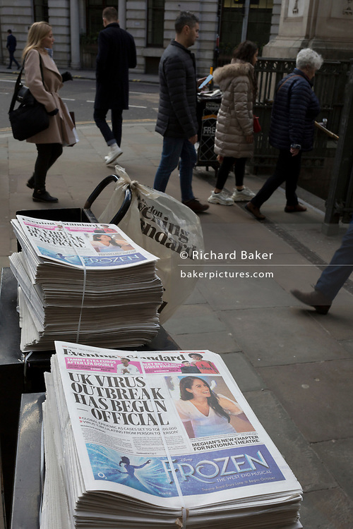 On the day that the UK Government's Chief Scientific Advisor, Sir Patrick Vallance said that the Coronavirus Covid-19 outbreak was now spreading person to person in the UK, bound copies of the latest edition of the London Evening Standard newspaper await readers outside Bank underground station in the City of London, on 6th March 2020, in London, England.