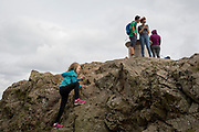 A young girl climbs the last feet of granite at the summit of The Beacon, on 15th September 2018, in Malvern, Worcestershire, England UK. Worcestershire Beacon, also popularly known as Worcester Beacon, or locally simply as The Beacon, is a hill whose summit at 425 metres (1,394 ft)[1] is the highest point of the range of Malvern Hills that runs about 13 kilometres (8.1 mi) north-south along the Herefordshire-Worcestershire border, although Worcestershire Beacon itself lies entirely within Worcestershire.