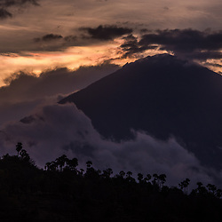 """Stratovolcano Mount Agung (Gunung Agung) is Bali's spiritual icon and the highest point on the island. It dominates the surrounding area, influencing the climate, especially rainfall patterns. <br /> * Image taken 2 weeks before the """"rumbling"""" of Mt. Agung. In September 2017, the area experienced 844 volcanic earthquakes, peaking at 300 to 400 earthquakes on 26 September. The frequency and intensity of these quakes caused much alarm among seismologists, as similar volcanoes have historically been known to erupt with even fewer warning signs. In late September the alert level was raised to the highest level, much of the kettle and 122,500 locals were evacuated from their houses around the volcano."""