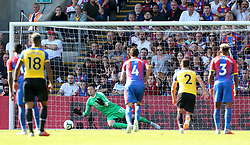 Crystal Palace goalkeeper Wayne Hennessey saves a penalty from Southampton's Charlie Austin during the Premier League match at Selhurst Park, London.