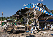 A burnt van rests at Super Save Gas station after a fire August 4, 2008, in Revelstoke, British Columba, Canada.