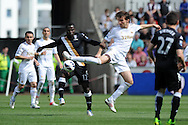 Swansea city's Michu battles for the ball with Fulham's Emmanuel Frimpong . Barclays Premier league, Swansea city v Fulham at the Liberty Stadium in Swansea, South Wales on Sunday 19th May 2013. pic by Andrew Orchard,  Andrew Orchard sports photography,