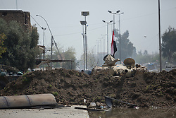 Licensed to London News Pictures. 02/04/2017. Mosul, Iraq. The turret of an Iraqi army T-72 tank pokes above a defensive bank in West Mosul, Iraq, close to the current front line between Iraqi Security Forces and the Islamic State.<br /> <br /> Iraqi forces continue to fight house to house as they push further into West Mosul. Iraqi forces are now advancing on the city's old districts where Islamic State fighters still hold out. Photo credit: Matt Cetti-Roberts/LNP