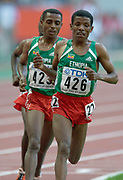 Haile Gebrselassie leads countrymen Kenenisa Bekele (423) and Sileshi Sihine in the 10,000 meters in the IAAF World Championships in Athletics at Stade de France on Sunday, Aug, 24, 2003.