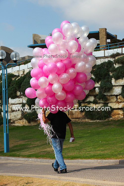 Man with pink and white balloons