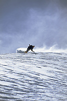 A snowboarder carves a turn in the Jackson Hole backcountry, Jackson Hole, Wyoming.