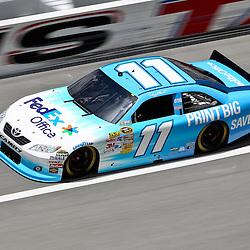 April 16, 2011; Talladega, AL, USA; NASCAR Sprint Cup Series driver Denny Hamlin (11) during qualifying for the Aarons 499 at Talladega Superspeedway.   Mandatory Credit: Derick E. Hingle