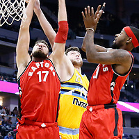 18 November 2016: Toronto Raptors center Jonas Valanciunas (17) vies for the rebound with Denver Nuggets center Jusuf Nurkic (23)  during the Toronto Raptors 113-111 OT victory over the Denver Nuggets, at the Pepsi Center, Denver, Colorado, USA.