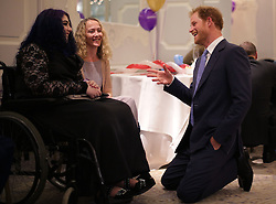 Prince Harry (right) reacts as he speaks with Inspirational Young Person Award Winner Nikita Fairclough (left), and her mother Lara, as he attends the WellChild Awards in London. The awards recognise the courage of seriously ill children, their families and carers.