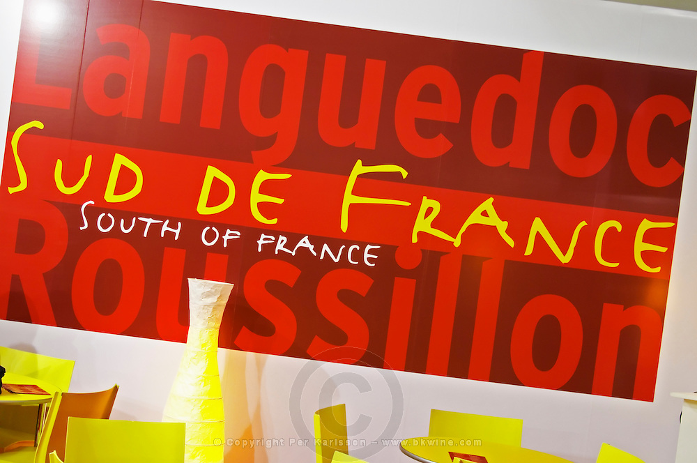 Poster with Languedoc Roussillon Sud de France South of France, the new slogan for the wines from this region, on a red and yellow poster on a wall in a cafe at the launch of the branding at the Vinisud trade fair in Montpellier, France.