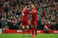 Football - 2019 / 2020 Premier League - Liverpool vs. Southampton<br /> <br /> Liverpool's Jordan Henderson hands the captains armband to Liverpool's Virgil van Dijk<br /> <br /> Colorsport / Terry Donnelly