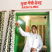 CAPTION: Dr Ram Chandra Soren, the area's Medical Officer-in-Charge, notes that adolescents tend to be reluctant to visit their CHCs, preferring private clinics and 'quacks', because they assume that they will not get what they need there, or that there will be insufficient privacy. He assures them that they can get what they need from the ARSH clinic with full privacy and confidentiality. Changing awareness about this has resulted in significant positive changes, such as a marked reduction in septic abortions. LOCATION: Adolescent Reproductive and Sexual Health (ARSH) clinic, Ghatshila Community Health Centre (CHC), Purbi Singhbhum (district), Jharkhand (state), India. INDIVIDUAL(S) PHOTOGRAPHED: Dr Ram Chandra Soren.