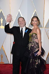 Producer Harvey Weinstein (L) and designer Georgina Chapman arriving for the 89th Academy Awards (Oscars) ceremony at the Dolby Theater in Los Angeles, CA, USA, February 26, 2017. Photo by Lionel Hahn/ABACAPRESS.COM
