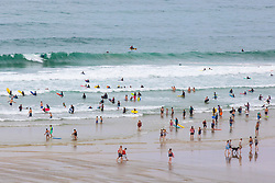 © Licensed to London News Pictures. 02/08/2018. Perranporth, UK. Large numbers of people go swimming and surfing in the hot weather on Perranporth beach in Cornwall.  Photo credit : Tom Nicholson/LNP