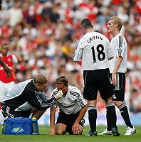 Photo: Steve Bond.<br />Arsenal v Derby County. The FA Barclays Premiership. 22/09/2007. Eddie Lewis recieves treatment