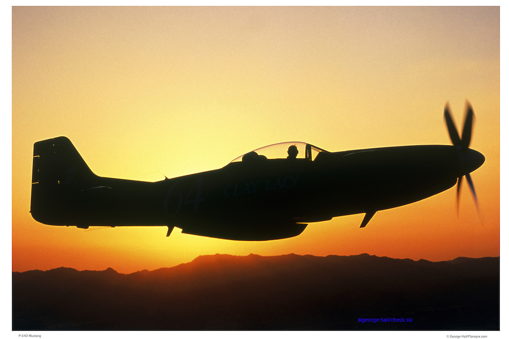 P-51D Mustang air-to-air, silhouetted against sunset