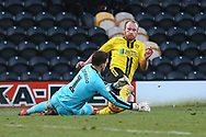 Burton Albion forward Liam Boyce (27) slides in as the ball is saved by Oxford United's goalkeeper Simon Eastwood (1) during the EFL Sky Bet League 1 match between Burton Albion and Oxford United at the Pirelli Stadium, Burton upon Trent, England on 2 February 2019.