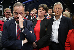 (From the left) DUP deputy leader Nigel Dodds, leader Arlene Foster and former leader Peter Robinson at the Titanic exhibition centre in Belfast where counting is taking place in the 2017 General Election.