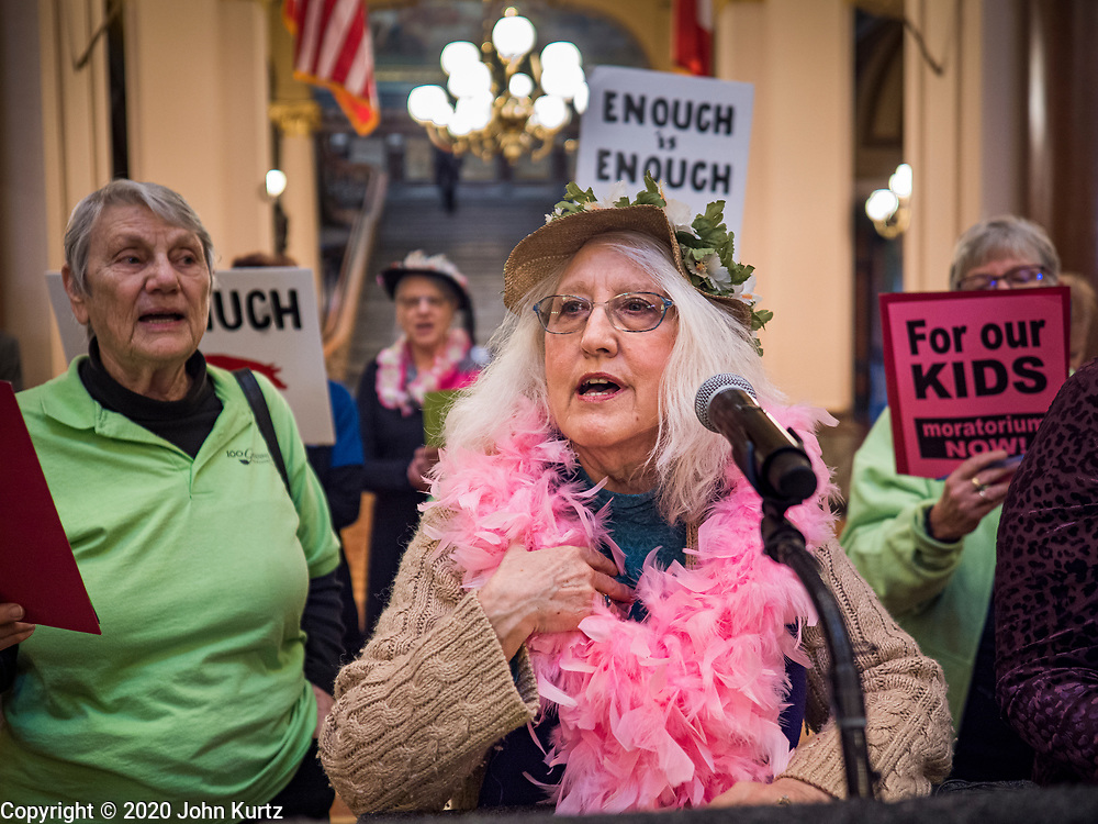 """23 JANUARY 2020 - DES MOINES, IOWA: JAN HILL, from Des Moines, a member of the """"Raging Grannies,"""" leads a song about the dangers of factory farms during a rally in the Iowa State Capitol against factory farms. About 75 people, including farmers, environmental activists, and supporters of family farms, came to a protest in the rotunda of the state capitol in Des Moines. They are trying to pressure Iowa lawmakers to pass a moratorium against new factory farm construction in Iowa.       PHOTO BY JACK KURTZ"""