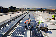 Installaion of Grid-tied solar array on roof of Big Blue Bus facilites, Installation by Martifer Solar USA, Santa Monica, California, USA