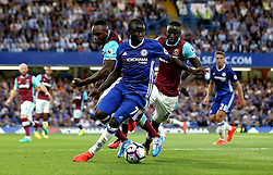 Ngolo Kante of Chelsea runs with the ball away from Cheikhou Kouyate, and Michail Antonio of West Ham United - Mandatory by-line: Robbie Stephenson/JMP - 15/08/2016 - FOOTBALL - Stamford Bridge - London, England - Chelsea v West Ham United - Premier League