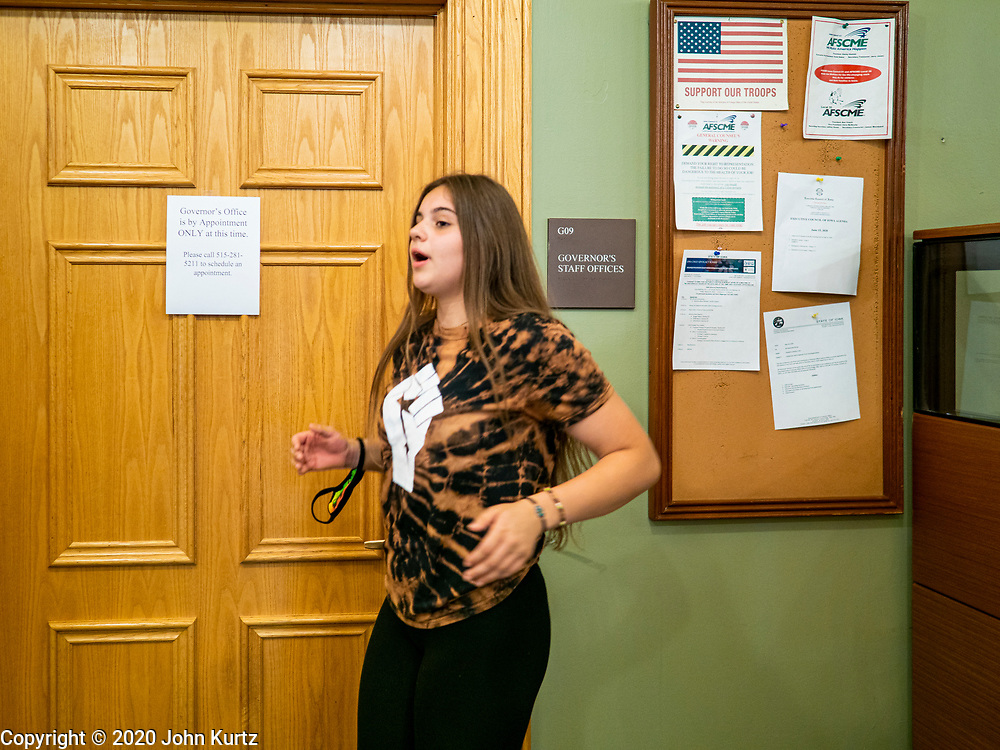 19 JUNE 2020 - DES MOINES, IOWA: LAUREN BENSON, from Des Moines, pounds on the wall of the Governor's office during a Juneteenth rally in the Iowa State Capitol. About 100 supporters of Des Moines Black Lives Matter finished their week long series of protests at the Iowa State Capitol with a Juneteenth rally and demonstration. They are demanding that Gov. Kim Reynolds use an executive order to restore voting rights to felons who have completed their sentences. The protesters did not meet with the Governor Friday. The protest was peaceful.      PHOTO BY JACK KURTZ