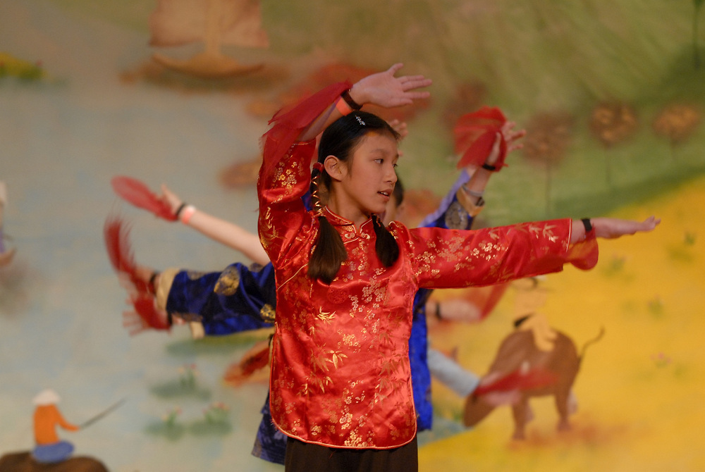 """Austin, TX February, 2006: Sixth Grade students perform """"Dreams Come True"""" (Uoc Mo Thanh Su That') at the Vietnamese New Year (Tet) show at Walnut Creek Elementary School which celebrates the Year of the Dog in the active Vietnamese community in north Austin. <br /> ©Bob Daemmrich/"""