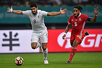"""Luis Suarez, left, of Uruguay national football team kicks the ball to make a pass against Ashley Williams of Wales national football team in their final match during the 2018 Gree China Cup International Football Championship in Nanning city, south China's Guangxi Zhuang Autonomous Region, 26 March 2018.<br /> <br /> Edinson Cavani's goal in the second half helped Uruguay beat Wales to claim the title of the second edition of China Cup International Football Championship here on Monday (26 March 2018). """"It was a tough match. I'm very satisfied with the result and I think that we can even get better if we didn't suffer from jet lag or injuries. I think the result was very satisfactory,"""" said Uruguay coach Oscar Tabarez. Wales were buoyed by a 6-0 victory over China while Uruguay were fresh from a 2-0 win over the Czech Republic. Uruguay almost took a dream start just 3 minutes into the game as Luis Suarez's shot on Nahitan Nandez cross smacked the upright. Uruguay were dealt a blow on 8 minutes when Jose Gimenez was injured in a challenge and was replaced by Sebastian Coates. Inter Milan's midfielder Matias Vecino of Uruguay also fired at the edge of box from a looped pass but only saw his attempt whistle past the post. Suarez squandered a golden opportunity on 32 minutes when Ashley Williams's wayward backpass sent him clear, but the Barca hitman rattled the woodwork again with goalkeeper Wayne Hennessey well beaten."""