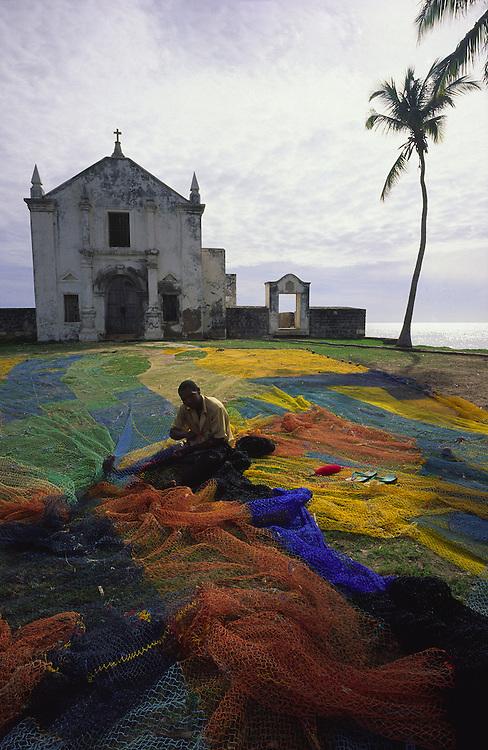Fisherman compose nets near Saint Anthony Chapel in Ilha de Mozambique