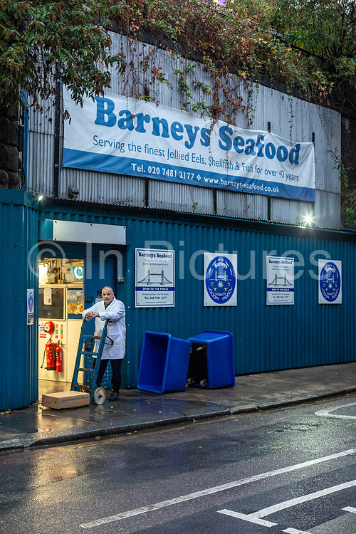 A portrait of worker Mark Peacham on the last day at the historic Barneys Seafood in Aldgate before a move to Billingsgate Market. The famous wholesale jellied eel and shellfish business started in 1969 supplying Pie and Mash shops and shellfish stalls in East London. Jellied eels are a traditional London dish. London, United Kingdom.